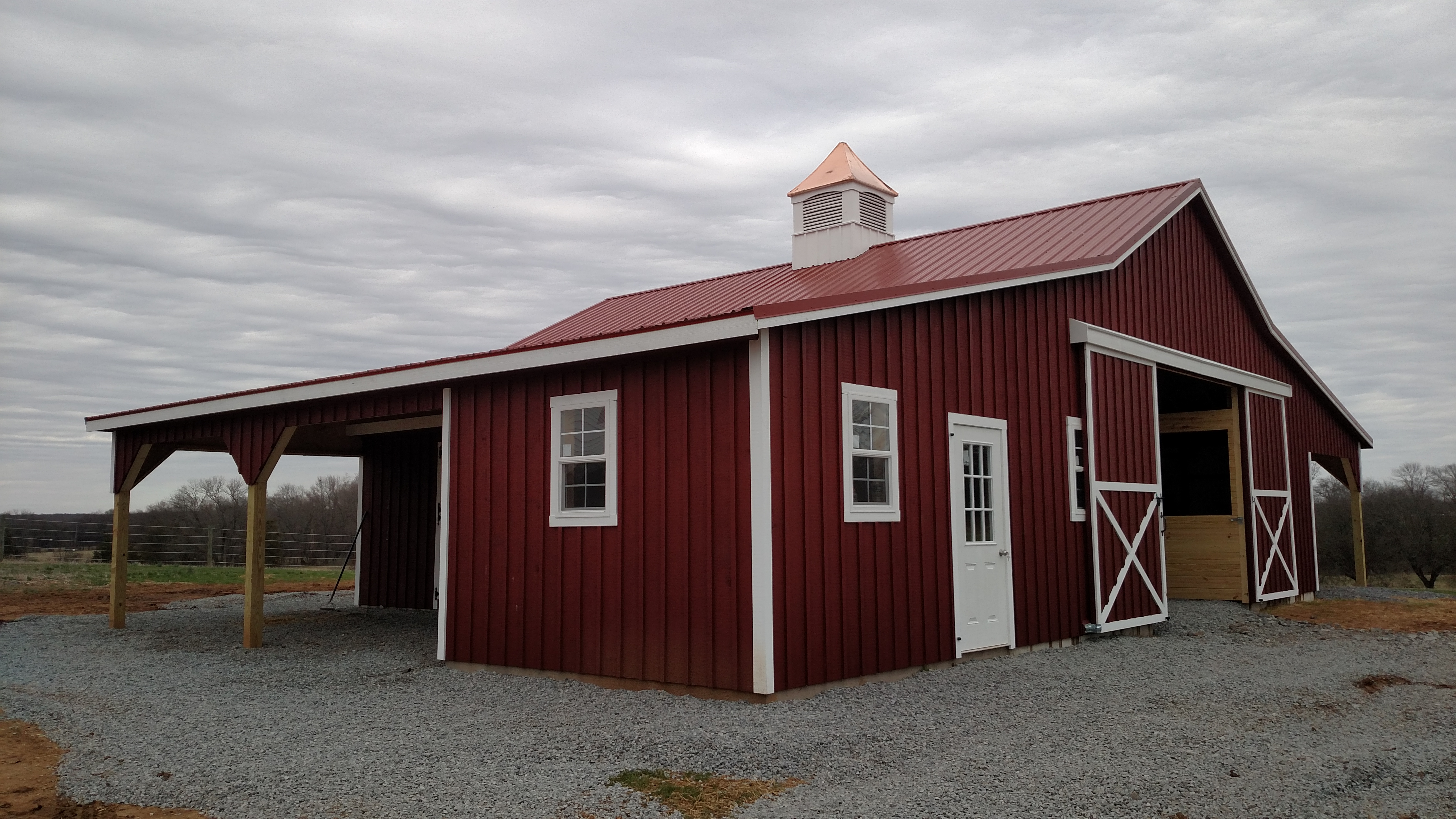 This barn has 5 stalls with 10' open lean to's on each side for extra weather protection for horses. The tack room is extended out into the lean to creating a spacious 12x22 tack room.
