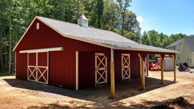 This barn has the standard painted board and batten siding along with architectural shingles.